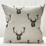 Charcoal stag cushion
